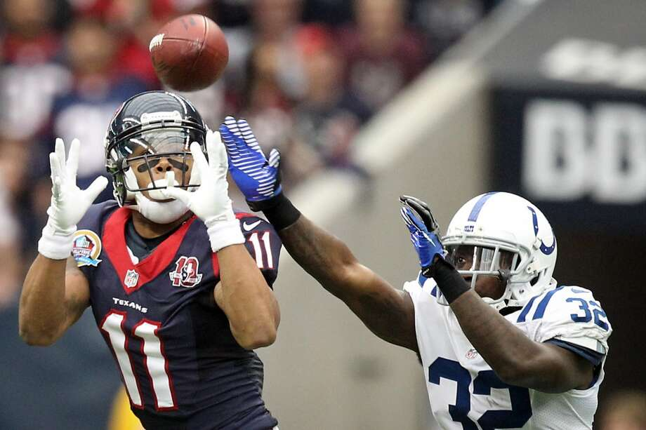 Texans wide receiver DeVier Posey (11) makes a first down catch as Colts cornerback Cassius Vaughn (32) tries to defend during the second quarter. (Nick de la Torre / Houston Chronicle)
