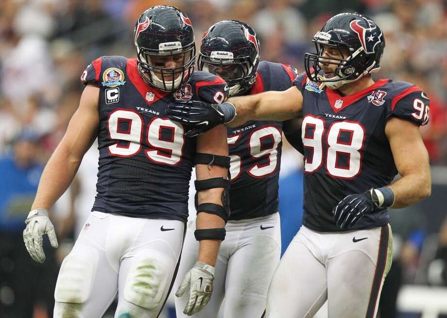 Texans defensive end J.J. Watt (99) is congratulated by linebacker Connor Barwin (98) after making a tackle during second quarter. (Nick de la Torre / Houston Chronicle)