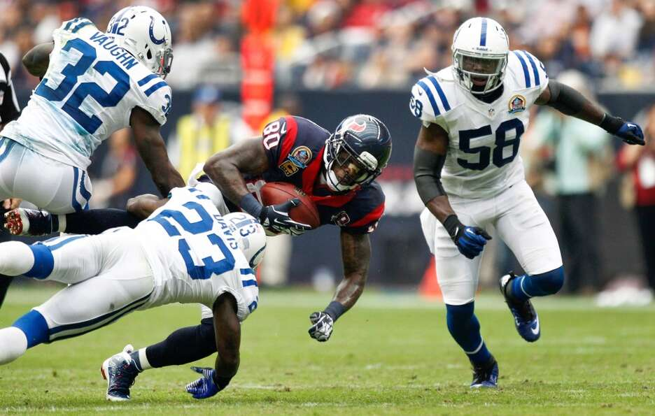 Texans wide receiver Andre Johnson (80) makes a catch between Colts defensive backs Cassius Vaughn (
