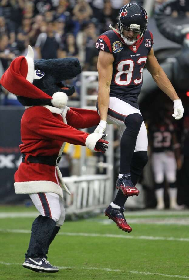 Houston Texans mascot Toro greets wide receiver Kevin Walter as the offense is introduced before the game. (Karen Warren / Houston Chronicle)