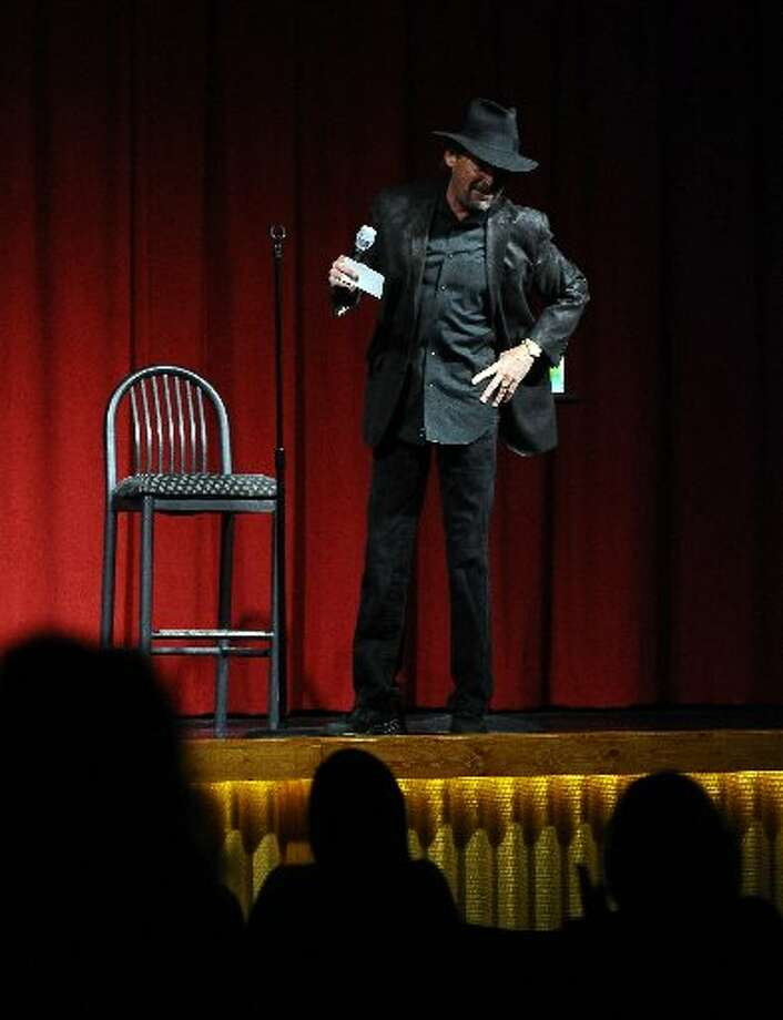Lee Melton gets the crowd warmed up for the upcoming comedians at Beaumont's premier comedy club, Laugh Out Loud. Randy Edwards/cat5