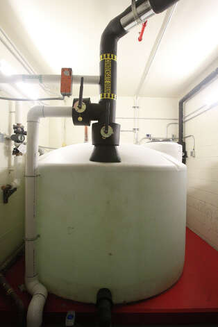 "A condensate collection tank gathers water in the basement of the Hipolito F. Garcia Federal Building. Water from air conditioning, nuisance groundwater and rain is used on the the building's vegetated ""green"" roof. Photo: JOHN DAVENPORT, San Antonio Express-News / ©San Antonio Express-News/Photo Can Be Sold to the Public"