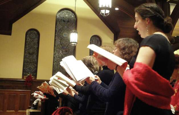 The alto section of the Messiah Sing at First Church Congregational on Sunday included singers from the Fairfield church's choir as well as the Trinity Episcopal Church choir in Newtown.  Fairfield CT 12/16/12 Photo: Meg Barone / Fairfield Citizen freelance