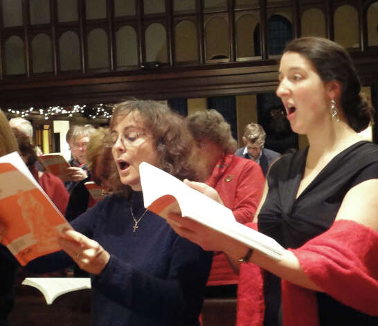 Meghan Murray, right, an alto with the First Church Congregational choir, joined members of the Trinity Episcopal Church choir in Newtown and the public in a Messiah Sing. Photo: Meg Barone / Fairfield Citizen freelance