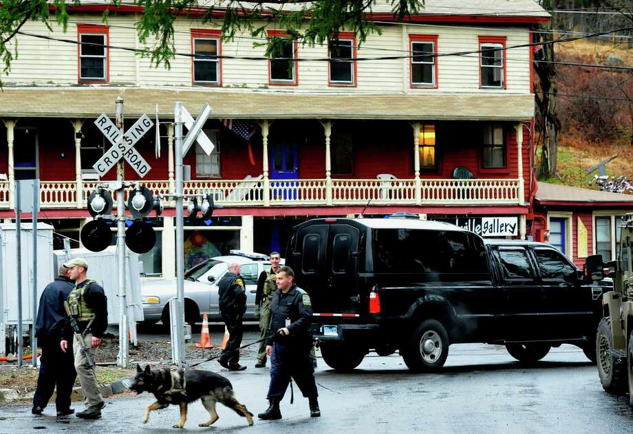 Police respond to a report of a man carring a rifle at the Branchville Train Station in Ridgefield Monday, Dec. 17, 2012. The report turned out to be false, police said. Photo: Michael Duffy