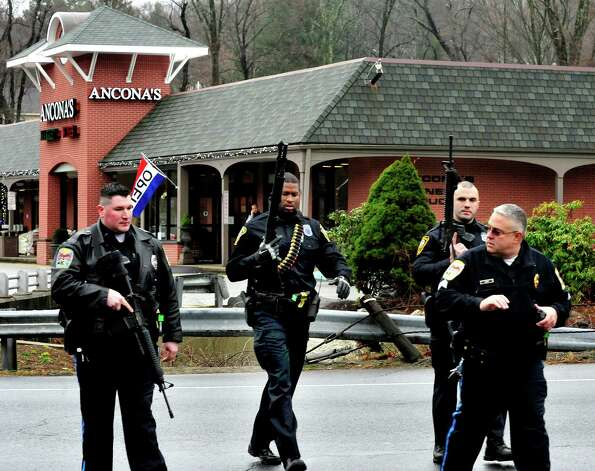 Norwalk Police respond to a report of a man carring a rifle at the Branchville Train Station in Ridgefield Monday, Dec. 17, 2012. The report turned out to be false, police said. Photo: Michael Duffy
