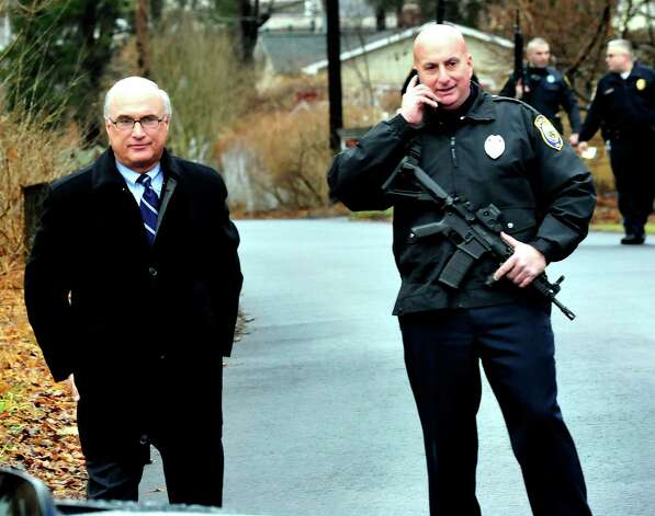 Ridgefield First Selectman Rudy Marconi, left, stands with police at Flordia Road leading to Branchville Elementary School as they respond to a report of a man carring a rifle at the Branchville Train Station in Ridgefield Monday, Dec. 17, 2012. The report turned out to be false, police said. Photo: Michael Duffy