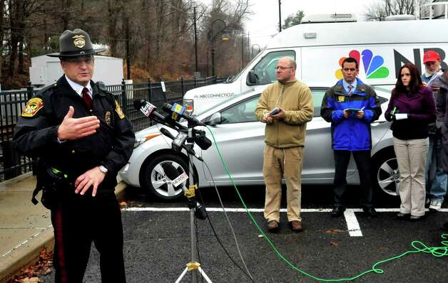 Ridgefield police spokesman Tom Comstock speaks at a press conference after police responded to a report of a man carring a rifle at the Branchville Train Station in Ridgefield Monday, Dec. 17, 2012. The report turned out to be false, police said. Photo: Michael Duffy