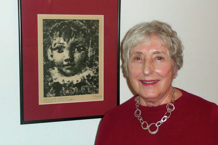 Seniority subject Barbara Martin stands next to a print by Picasso Picasso, which she picked up in Paris when she was working for Army Special Services in Germany. Photo: Anne W. Semmes