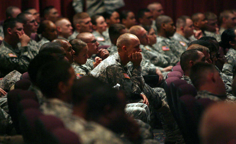 Soldiers  at Fort Hood listen to a spouse discuss  her Marine husband's suicide. Tragedy Assistance Program for Survivors works for suicide awareness and prevention.