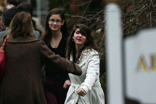 FAIRFIELD, CT - DECEMBER 17:  Three women greet each other as they arrive for the funeral services of six year-old Noah Pozner, who was  killed in the shooting massacre in Newtown, CT, at Abraham L. Green and Son Funeral Home on December 17, 2012 in Fairfield, Connecticut. Today is the first day of funerals for some of the twenty children and seven adults who were killed by 20-year-old Adam Lanza on December 14, 2012. Photo: Spencer Platt, Getty Images / 2012 Getty Images