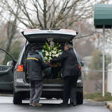 A florist delivers funeral bouquets for Noah Pozner's funeral December 17, 2012 at the Abraham L. Green and Son Funeral Home in Fairfield, Connecticut. Pozner, a six year-old Jewish boy who, along with 19 other classmates and 6 teachers was murdered by a lone gunman December 14 at the Sandy Hook Elementary Schoolin Newtown, Connecticut.  AFP PHOTO / Don EMMERT
