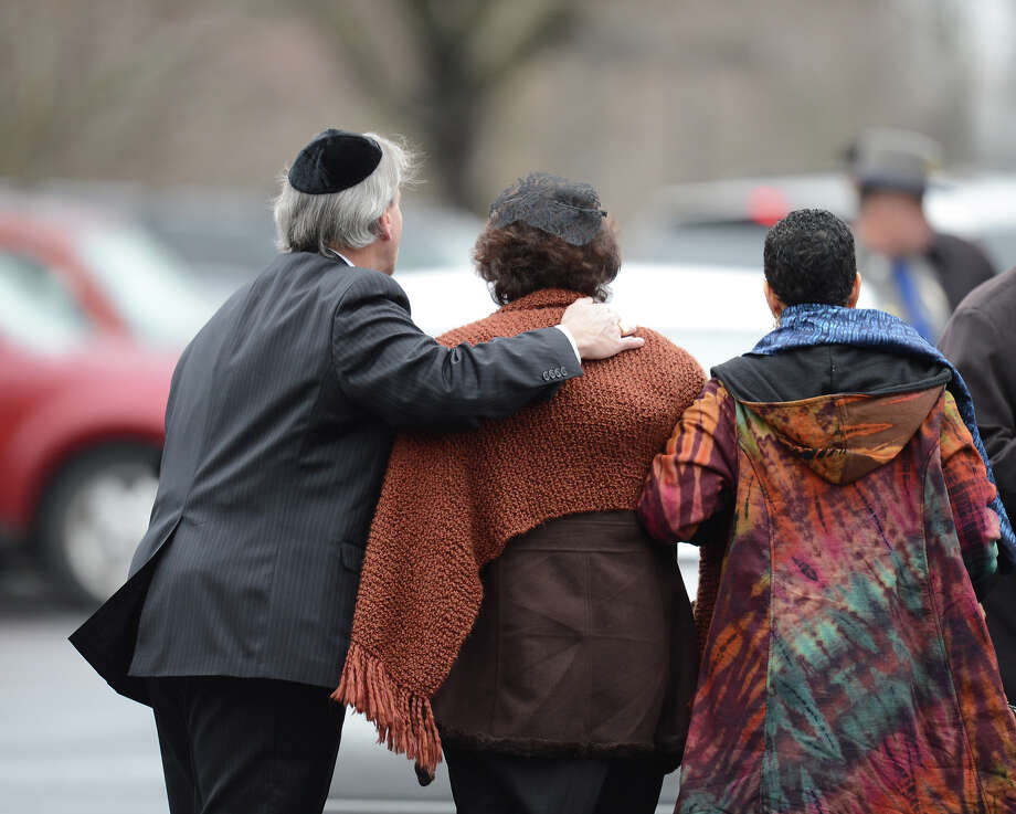 Veronika Pozner(C), mother of Noah Pozner, arrives for her son's funeral December 17, 2012 at the Abraham L. Green and Son Funeral Home in Fairfield, Connecticut.  Funerals began Monday after the school massacre that took the lives of 20 small children and six staff, triggering new momentum for a change to America's gun culture. The first burials, held under raw, wet skies, were for two six-year-old boys who were among those shot in Sandy Hook Elementary School. On Tuesday, the first of the girls, also aged six, was due to be laid to rest. There were no Monday classes at all across Newtown, and the blood-soaked elementary school was to remain a closed crime scene indefinitely, authorities said.    AFP PHOTO/Don Emmert Photo: DON EMMERT, AFP/Getty Images / 2012 AFP