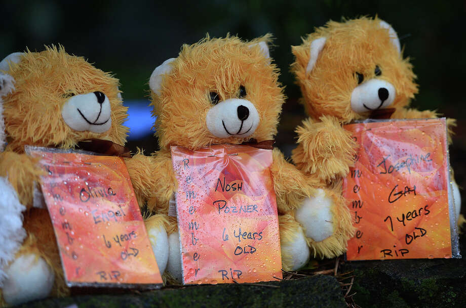 Teddy bears with the names of some of the victims of the December 14, 2012 elementary school shooting, including Six-year-old Noah Pozner, at a makeshift shrine to the victims in Newtown, Connecticut, December  on 17, 2012. Funerals began Monday in the little Connecticut town of Newtown after the school massacre that took the lives of 20 small children and six staff, triggering new momentum for a change to America's gun culture. The first burials, held under raw, wet skies, were for two six-year-old boys who were among those shot in Sandy Hook Elementary School. On Tuesday, the first of the girls, also aged six, was due to be laid to rest. There were no Monday classes at all across Newtown, and the blood-soaked elementary school was to remain a closed crime scene indefinitely, authorities said. AFP PHOTO/Emmanuel DUNAND Photo: EMMANUEL DUNAND, AFP/Getty Images / 2012 AFP