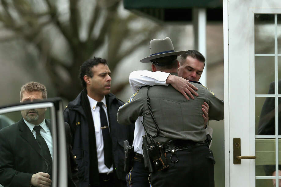 Fairfield Police Chief Gary MacNamara, right, and Lt. Jim Perezl, left, arrive for the funeral services of six year-old Noah Pozner, who was  killed in the shooting massacre in Newtown, CT, at Abraham L. Green and Son Funeral Home on December 17, 2012 in Fairfield, Connecticut. Today is the first day of funerals for some of the twenty children and seven adults who were killed by 20-year-old Adam Lanza on December 14, 2012. Photo: Spencer Platt, Getty Images / 2012 Getty Images
