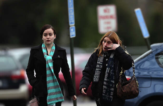 FAIRFIELD, CT - DECEMBER 17:   Two women arrive for the funeral services of six year-old Noah Pozner, who was  killed in the shooting massacre in Newtown, CT, at Abraham L. Green and Son Funeral Home on December 17, 2012 in Fairfield, Connecticut. Today is the first day of funerals for some of the twenty children and seven adults who were killed by 20-year-old Adam Lanza on December 14, 2012. Photo: Spencer Platt, Getty Images / 2012 Getty Images