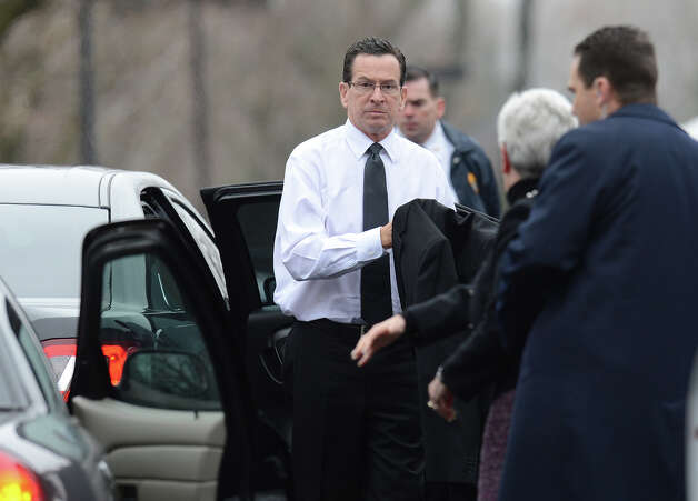 Connecticut Governor Dannel Malloy(C) arrives for the funeral of Noah Pozner  December 17, 2012 at the Abraham L. Green and Son Funeral Home in Fairfield, Connecticut. Pozner, a six year-old Jewish boy who, along with 19 other classmates and 6 teachers was murdered by a lone gunman December 14 at the Sandy Hook Elementary School in Newtown, Connecticut.  AFP PHOTO / Don EMMERT Photo: DON EMMERT, AFP/Getty Images / 2012 AFP