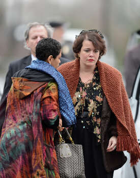 Veronika Pozner(C), mother of Noah Pozner, arrives for her son's funeral December 17, 2012 at the Abraham L. Green and Son Funeral Home in Fairfield, Connecticut. Pozner, a six year-old Jewish boy who, along with 19 other classmates and 6 teachers was murdered by a lone gunman December 14 at the Sandy Hook Elementary School in Newtown, Connecticut.  AFP PHOTO / Don EMMERT Photo: DON EMMERT, AFP/Getty Images / 2012 AFP