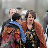 Veronika Pozner(C), mother of Noah Pozner, arrives for her son's funeral December 17, 2012 at the Abraham L. Green and Son Funeral Home in Fairfield, Connecticut. Pozner, a six year-old Jewish boy who, along with 19 other classmates and 6 teachers was murdered by a lone gunman December 14 at the Sandy Hook Elementary School in Newtown, Connecticut.  AFP PHOTO / Don EMMERT