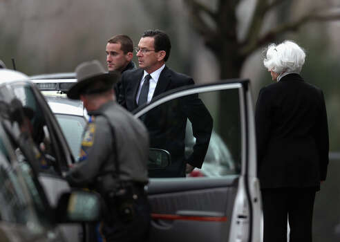 FAIRFIELD, CT - DECEMBER 17:  Connecticut Gov. Dan Malloy (C) arrives for the funeral services of six year-old Noah Pozner, who was  killed in the shooting massacre in Newtown, CT, at Abraham L. Green and Son Funeral Home on December 17, 2012 in Fairfield, Connecticut. Today is the first day of funerals for some of the twenty children and seven adults who were killed by 20-year-old Adam Lanza on December 14, 2012. Photo: Spencer Platt, Getty Images / 2012 Getty Images