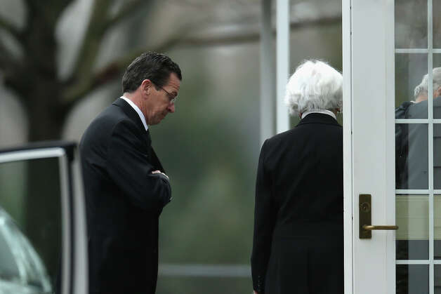 FAIRFIELD, CT - DECEMBER 17:  Connecticut Gov. Dan Malloy (L) arrives for the funeral services of six year-old Noah Pozner, who was  killed in the shooting massacre in Newtown, CT, at Abraham L. Green and Son Funeral Home on December 17, 2012 in Fairfield, Connecticut. Today is the first day of funerals for some of the twenty children and seven adults who were killed by 20-year-old Adam Lanza on December 14, 2012. Photo: Spencer Platt, Getty Images / 2012 Getty Images