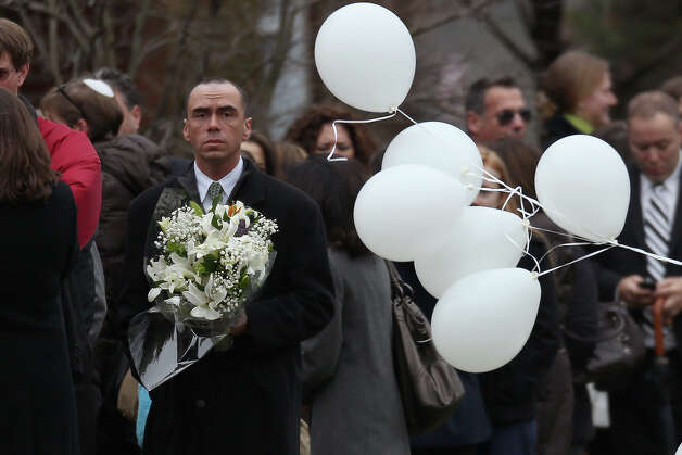 FAIRFIELD, CT - DECEMBER 17:  People arrive for the funeral services of six year-old Noah Pozner, who was  killed in the shooting massacre in Newtown, CT, at Abraham L. Green and Son Funeral Home on December 17, 2012 in Fairfield, Connecticut. Today is the first day of funerals for some of the twenty children and seven adults who were killed by 20-year-old Adam Lanza on December 14, 2012. Photo: Spencer Platt, Getty Images / 2012 Getty Images