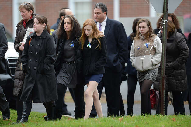 Mourners leave after Noah Pozner's funeral December 17, 2012 at the Abraham L. Green and Son Funeral Home in Fairfield, Connecticut. Pozner, a six year-old Jewish boy who, along with 19 other classmates and 6 teachers was murdered by a lone gunman December 14 at the Sandy Hook Elementary School in Newtown, Connecticut.  AFP PHOTO / Don EMMERT Photo: DON EMMERT, AFP/Getty Images / 2012 AFP