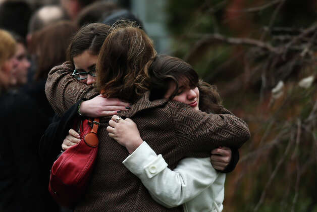 FAIRFIELD, CT - DECEMBER 17:  Three women embrace as they arrive for the funeral services of six year-old Noah Pozner, who was  killed in the shooting massacre in Newtown, CT, at Abraham L. Green and Son Funeral Home on December 17, 2012 in Fairfield, Connecticut. Today is the first day of funerals for some of the twenty children and seven adults who were killed by 20-year-old Adam Lanza on December 14, 2012. Photo: Spencer Platt, Getty Images / 2012 Getty Images