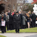 Mourners leave after Noah Pozner's funeral December 17, 2012 at the Abraham L. Green and Son Funeral Home in Fairfield, Connecticut. Pozner, a six year-old Jewish boy who, along with 19 other classmates and 6 teachers was murdered by a lone gunman December 14 at the Sandy Hook Elementary School in Newtown, Connecticut.  AFP PHOTO / Don EMMERT