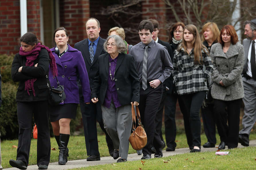 FAIRFIELD, CT - DECEMBER 17:  People arrive for the funeral services of six year-old Noah Pozner, wh