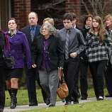 FAIRFIELD, CT - DECEMBER 17:  People arrive for the funeral services of six year-old Noah Pozner, who was  killed in the shooting massacre in Newtown, CT, at Abraham L. Green and Son Funeral Home on December 17, 2012 in Fairfield, Connecticut. Today is the first day of funerals for some of the twenty children and seven adults who were killed by 20-year-old Adam Lanza on December 14, 2012.