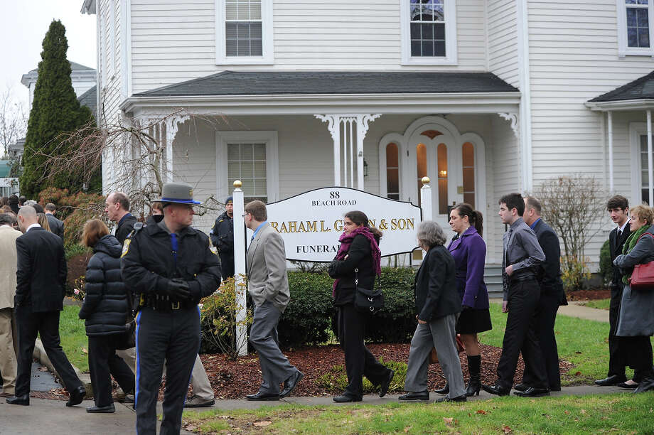 Mourners leave following the funeral of Noah Pozner December 17, 2012 at the Abraham L. Green and Son Funeral Home in Fairfield, Connecticut. Pozner, a six year-old Jewish boy who, along with 19 other classmates and 6 teachers was murdered by a lone gunman December 14 at the Sandy Hook Elementary School in Newtown, Connecticut.  AFP PHOTO / Don EMMERT Photo: DON EMMERT, AFP/Getty Images / 2012 AFP