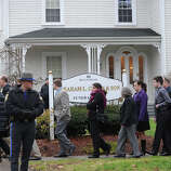 Mourners leave following the funeral of Noah Pozner December 17, 2012 at the Abraham L. Green and Son Funeral Home in Fairfield, Connecticut. Pozner, a six year-old Jewish boy who, along with 19 other classmates and 6 teachers was murdered by a lone gunman December 14 at the Sandy Hook Elementary School in Newtown, Connecticut.  AFP PHOTO / Don EMMERT