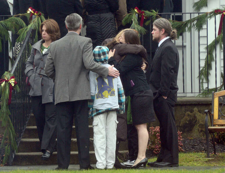 Mourners December 17, 2012 at the funeral for Jack Pinto, 6, one of the victims of the December 14,