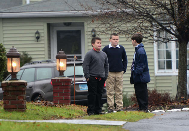 Young boys December 17, 2012 at the funeral for Jack Pinto, 6, one of the victims of the December 14, Sandy Hook elementary school shooting, in Newtown, Connecticut.  Funerals began Monday in the little Connecticut town of Newtown after the school massacre that took the lives of 20 small children and six staff, triggering new momentum for a change to America's gun culture. Photo: EMMANUEL DUNAND, AFP/Getty Images / 2012 AFP