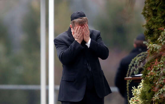 A mourner arrives at the funeral service for 6-year-old Noah Pozner, Monday, Dec. 17, 2012, in Fairfield, Conn. Pozner was killed when a gunman walked into Sandy Hook Elementary School in Newtown Friday and opened fire, killing 26 people, including 20 children. Photo: AP