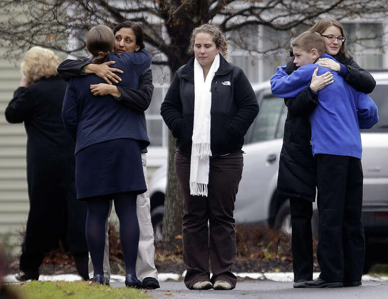 Mourners gather outside the funeral service of Sandy Hook Elementary School shooting victim, Jack Pi