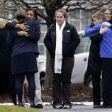 Mourners gather outside the funeral service of Sandy Hook Elementary School shooting victim, Jack Pinto, 6, Monday, Dec. 17, 2012, in Newtown, Conn. A gunman walked into Sandy Hook Elementary School in Newtown Friday and opened fire, killing 26 people, including 20 children.