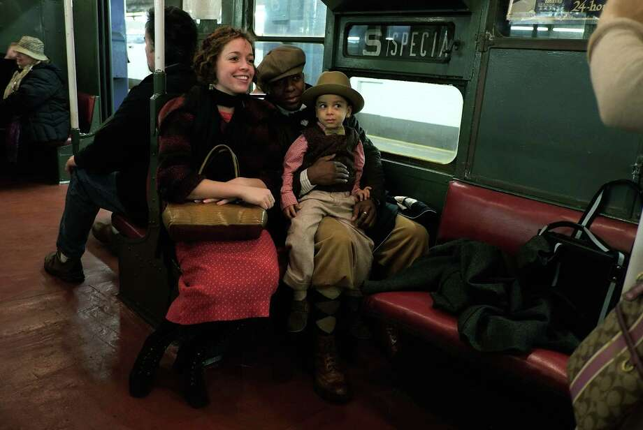NEW YORK, NY - DECEMBER 16:  People dressed in period costumes have their picture taken in a vintage New York City subway car on December 16, 2012 in New York City. The New York Metropolitan Transportation Authority (MTA) runs vintage subway trains from the 1930's-1970's each Sunday along the M train route from Manhattan to Queens through the first of the year. Photo: Preston Rescigno, Getty Images / 2012 Getty Images