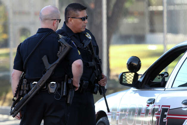 Police gather on the north side of Cambridge Elementary School during a lockdown situation Monday December 17, 2012. Photo: JOHN DAVENPORT, San Antonio Express-News / ©San Antonio Express-News/Photo Can Be Sold to the Public