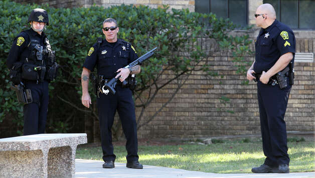 Police gather at Cambridge Elementary School during a lockdown situation Monday December 17, 2012. Photo: JOHN DAVENPORT, San Antonio Express-News / ©San Antonio Express-News/Photo Can Be Sold to the Public