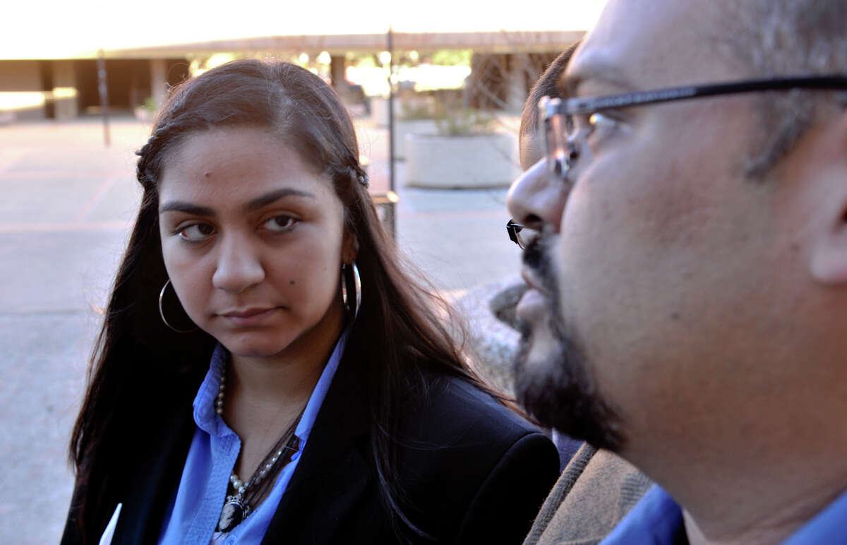 Andrea Hernandez listens to hear father, Steven, prior to a hearing in federal court concerning and RFID chip in her student ID.