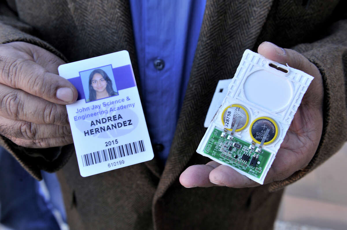 Steven Hernandez shows off the NISD student ID containing an RFID chip that daughter Andrea has refused to where.