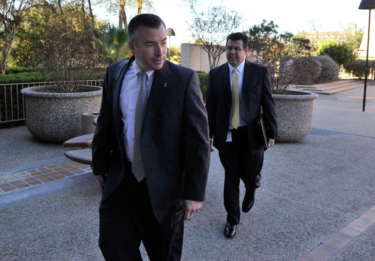 NISD Superintendent Dr. Brian Woods enters the federal courthouse with district attorney Craig Wood for a hearing on the RFID-equpped student ID belonging to Andrea Hernandez.