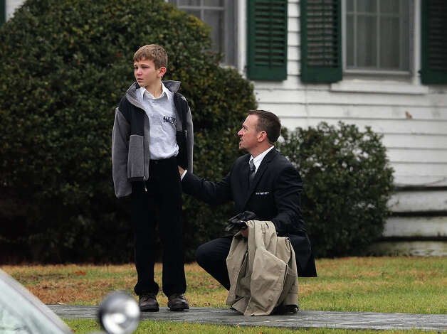 NEWTOWN, CT - DECEMBER 17:  A man comforts a boy outside Honan Funeral Home before the funeral for 6-year-old Jack Pinto on December 17, 2012 in Newtown Connecticut. Pinto was one of the 20 students killed in the Sandy Hook Elementary School mass shooting. Photo: Mario Tama, Getty Images / 2012 Getty Images