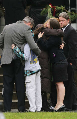 NEWTOWN, CT - DECEMBER 17:  Mourners embrace outside Honan Funeral Home before the funeral for 6-year-old Jack Pinto on December 17, 2012 in Newtown Connecticut. Pinto was one of the 20 students killed in the Sandy Hook Elementary School mass shooting. Photo: Mario Tama, Getty Images / 2012 Getty Images