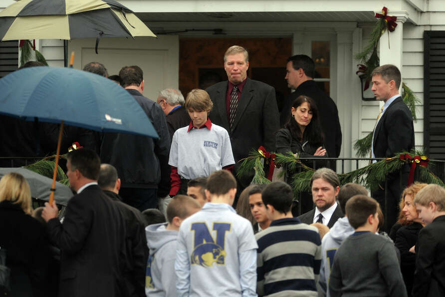 Mourners arrive at Honan Funeral Home, in Newtown, Conn., for the funeral of Jack Pinto, 6, on Dec.