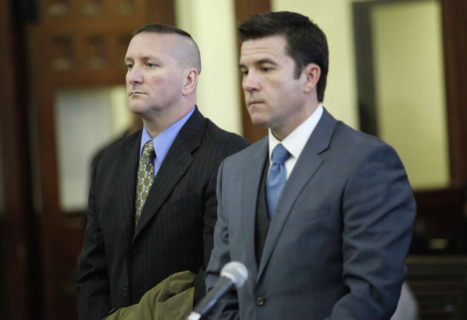 Connecticut State Police Trooper Aaron Huntsman, left, appears with attorney Ryan McGuigan in Bridgeport Superior Court on Monday, December 17, 2012. Huntsman plead not guilty to charges of stealing $3,000 and a gold chain from victim of a motorcycle accident. Photo: Unknown, B.K. Angeletti / Connecticut Post freelance B.K. Angeletti