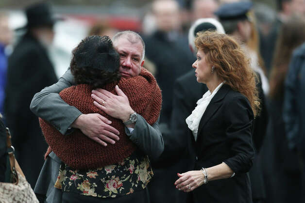 FAIRFIELD, CT - DECEMBER 17:  Veronika Pozner (L)  is hugged as she leaves the funeral services for her six year-old son Noah Pozner, who was  killed in the shooting massacre in Newtown, CT, at Abraham L. Green and Son Funeral Home on December 17, 2012 in Fairfield, Connecticut. Today is the first day of funerals for some of the twenty children and seven adults who were killed by 20-year-old Adam Lanza on December 14, 2012. Photo: Spencer Platt, Getty Images / 2012 Getty Images