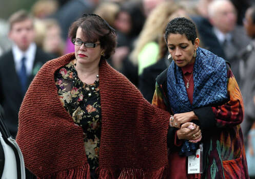 FAIRFIELD, CT - DECEMBER 17:  Veronika Pozner (L)  leaves the funeral services for her six year-old son Noah Pozner, who was  killed in the shooting massacre in Newtown, CT, at Abraham L. Green and Son Funeral Home on December 17, 2012 in Fairfield, Connecticut. Today is the first day of funerals for some of the twenty children and seven adults who were killed by 20-year-old Adam Lanza on December 14, 2012. Photo: Spencer Platt, Getty Images / 2012 Getty Images